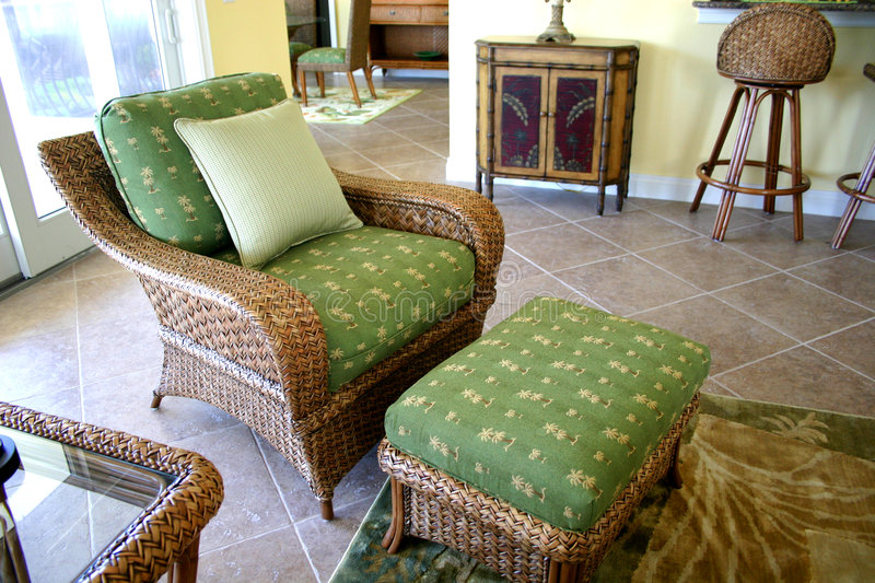 Lounging chair. Green upholstered lounging chair and ottoman in vacation condo on small island on coast of Gulf of Mexico royalty free stock photo