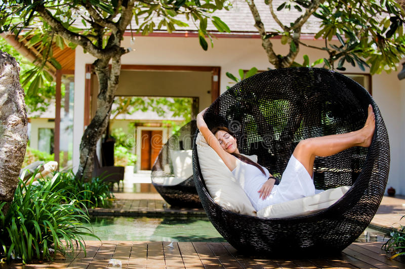 Lounging Outdoors. An attractive caucasian woman relaxing and lounging outdoors stock photos