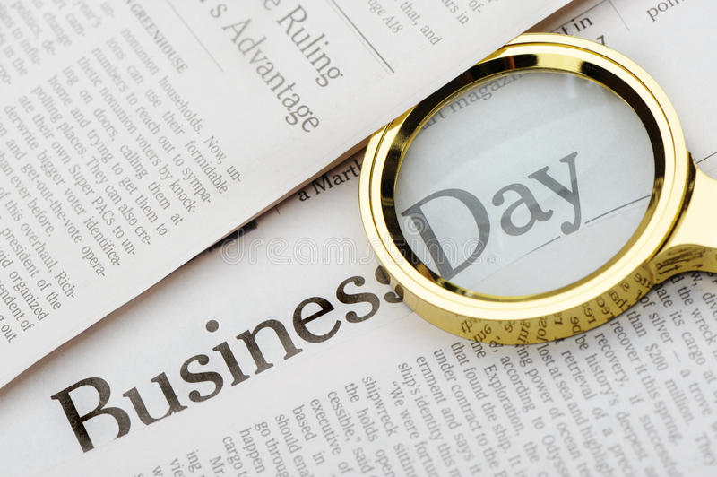 Loupe Lies On The Newspaper Royalty Free Stock Image