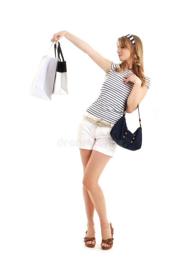 Louro alegre com sacos de compras fotografia de stock
