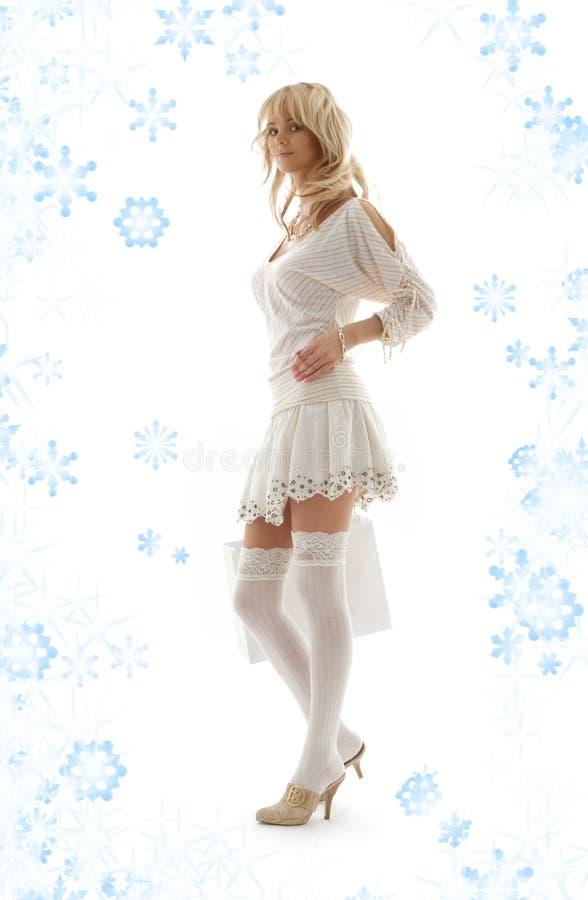 Louro com saco e flocos de neve de compra fotos de stock
