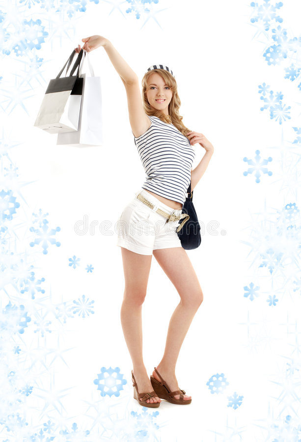Louro com sacos de compra e snowflakes#2 foto de stock royalty free
