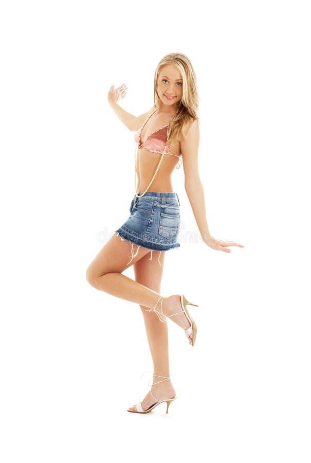Louro feliz na saia #2 da sarja de Nimes fotos de stock