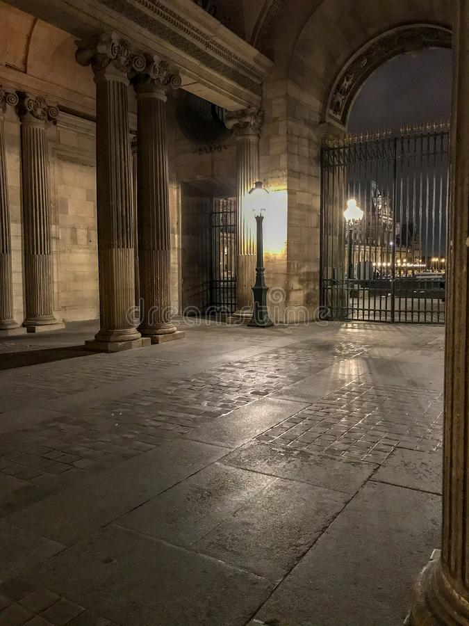 Louvre courtyard archway lit by evening lamp, Paris, France stock images