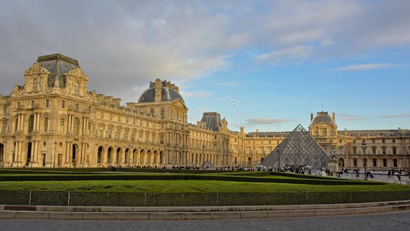 Louvre museum on a sunny autumn evening in PAris, France stock photography