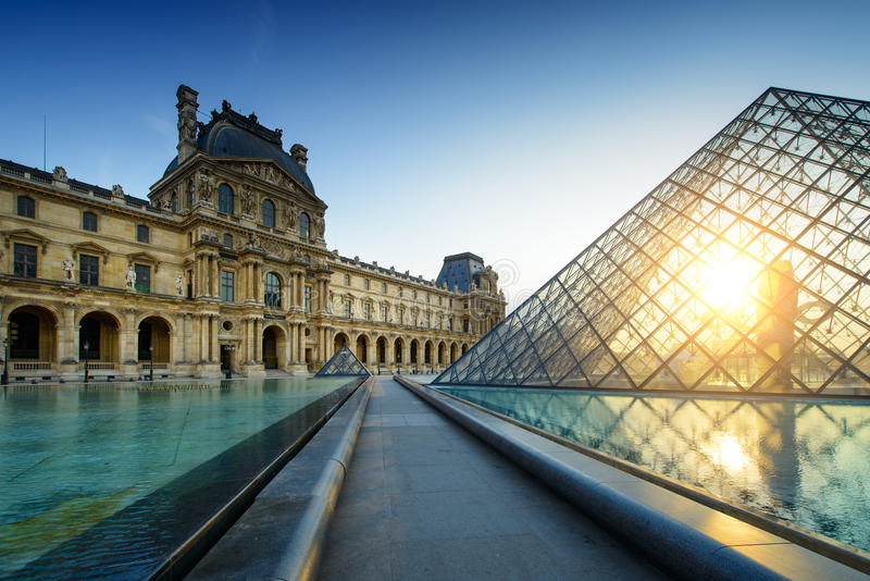 Louvre Museum Paris at sunset stock images