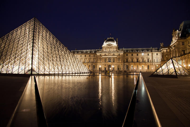 Louvre Museum with Pyramid stock photos