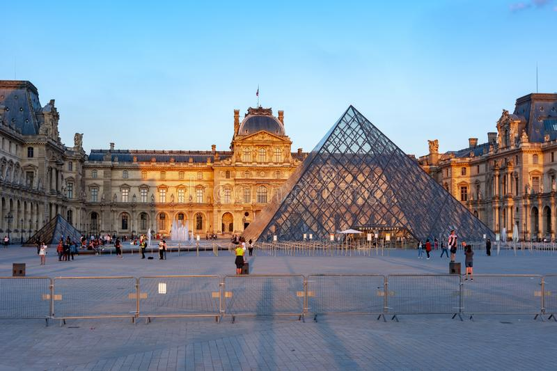 Louvre museum and pyramid at sunset, Paris, France royalty free stock image