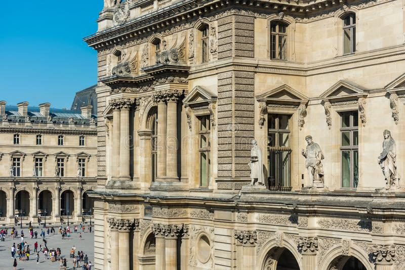 The  Louvre Museum at the right bank of Seine Rive, the world`s largest art museum and a historic monument in Paris, France. A royalty free stock photos