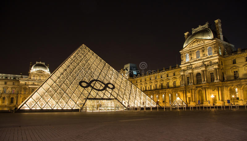The Louvre of Paris in France by night royalty free stock photography