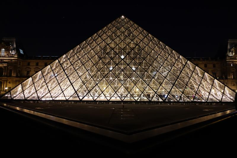 Louvre Pyramid, Paris, France. The symmetrical glass pyramid of the Louvre Museum in Paris photographed at night. Designed by architect I.M. Pei royalty free stock photo