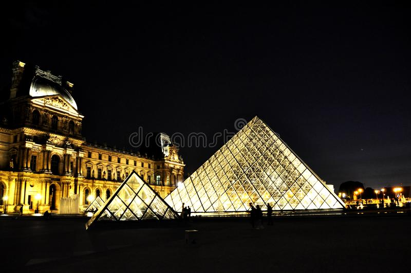 Louvre Pyramid in Paris, night with light stock images