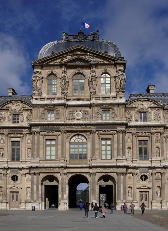 The Louvre.The square of Carre, on which tourists walk and take royalty free stock images