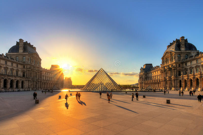 Louvre sunset shadows royalty free stock photography