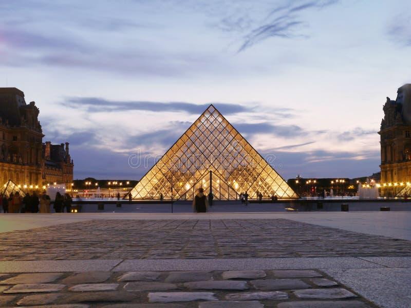 The Louvre - Symmetrical beauty under the Paris night stock images
