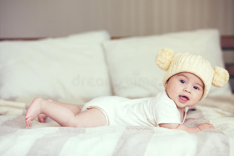 Lovable baby. Portrait of a lovable 5 months baby lying down on a blanket stock photos