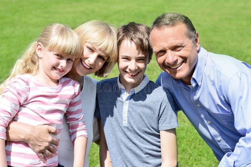 Lovable family enjoying sunny day outdoors stock photo