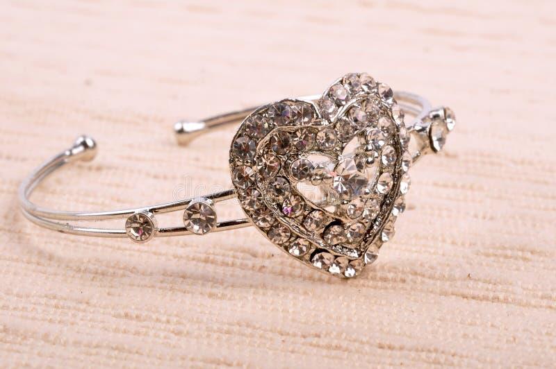 Love. Platinum love jewelry on mat stock photography