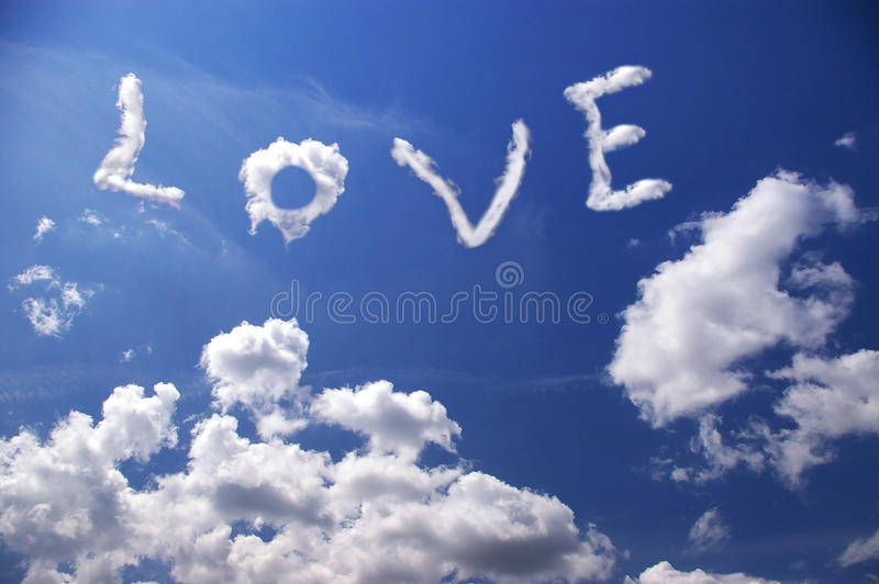 Love. Word love in white clouds on blue sky royalty free stock image