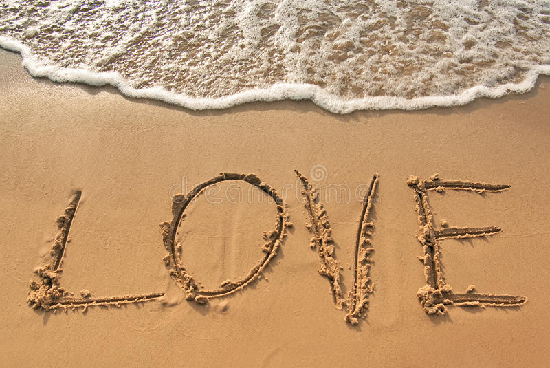 Love. And the Sea - The inscription beach sand royalty free stock photos