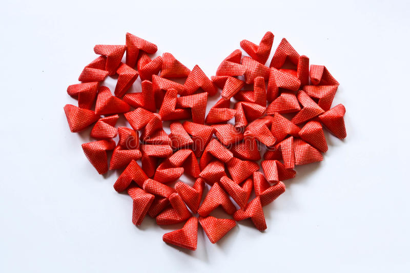 Love. Fold the red paper heart represents love stock photography