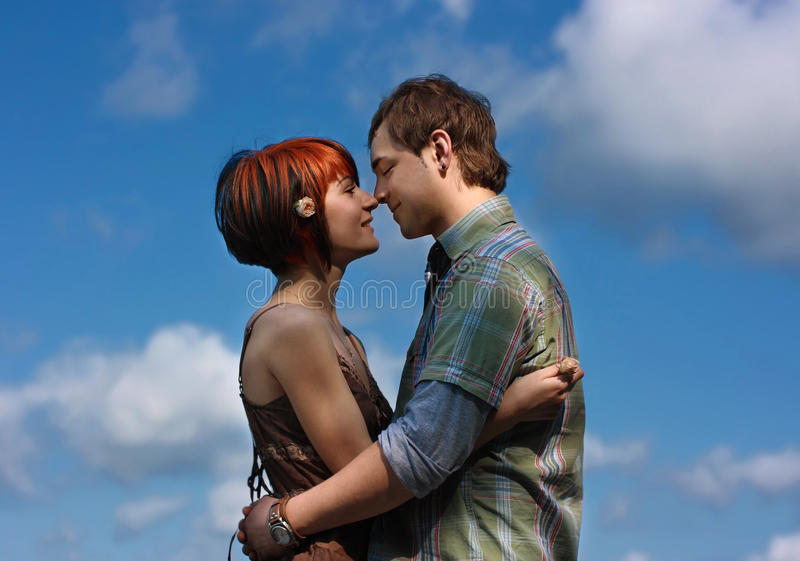 In love. Pair on a background blue sky stock photo