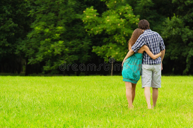 Love. Happy young couple in love walking at the park stock photography