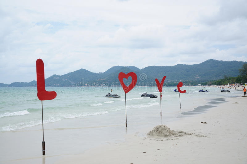 Love. On the white sand beach royalty free stock image