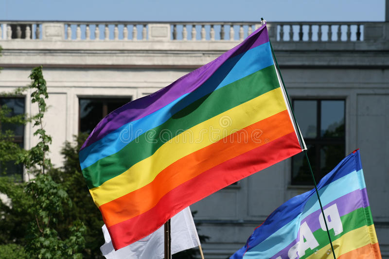 Love. Demonstration - love parade and rainbow flag over heads royalty free stock photo