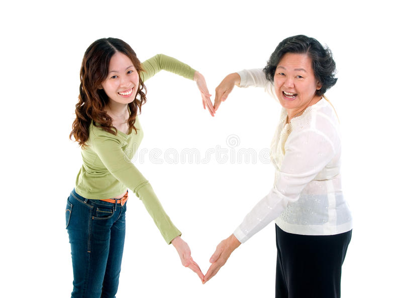 Love. Asian senior women and daughter making the sign of love royalty free stock photo