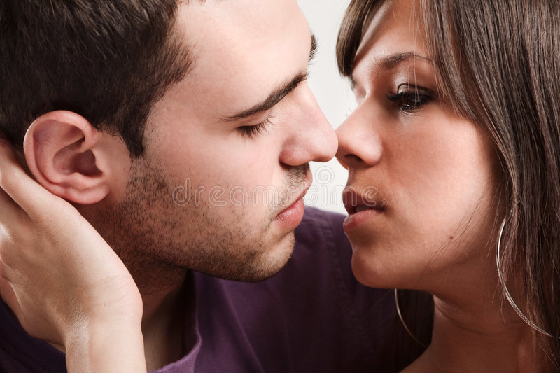 Love. Young couple in love, close up, studio shot stock images