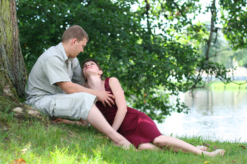 Love. Happy young couple relaxing near the river stock photography