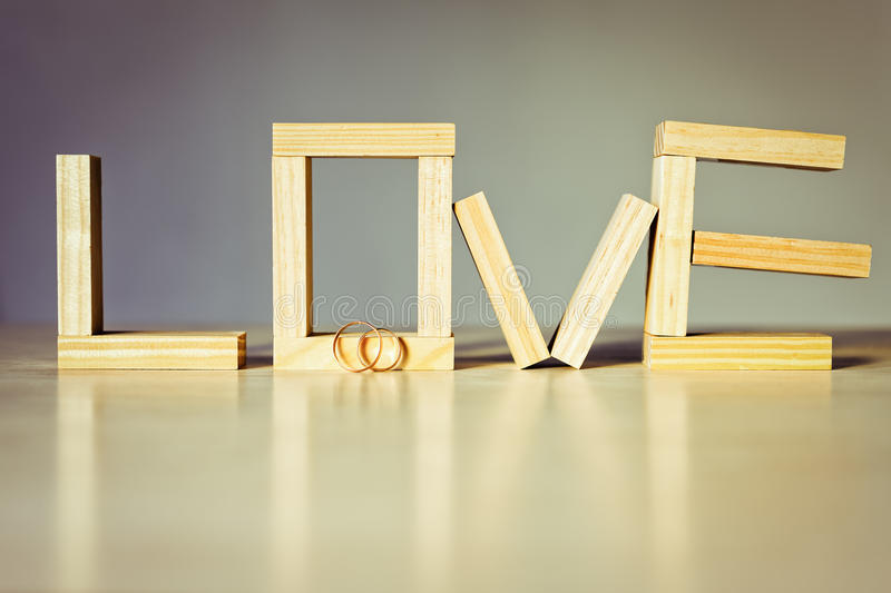 Love abstract background. With golden rings for proposing stock photography