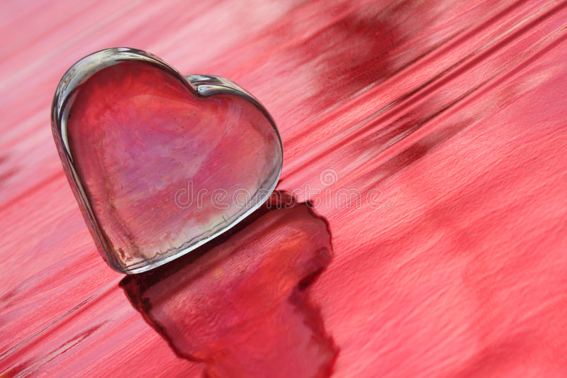 Love Abstraction. Valentine heart on the red background - the symbol of love stock photo