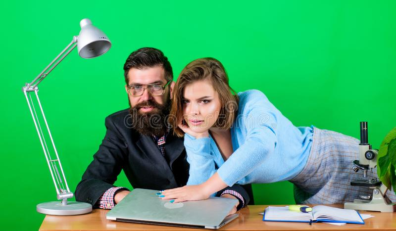 Love affair at work. Seduction. corporate ethics. businessman and assistant. sexy woman and man work in office at laptop royalty free stock photos