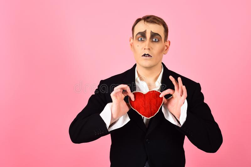 In love again and always. Mime man hold red heart for valentines day. Mime actor with love symbol. Theatre actor stock image