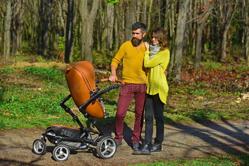 Love is in the air. Family couple stroll in park. Couple of woman and man walk with baby pram outdoor. Love is in the air. Family couple stroll in park. Couple royalty free stock photos