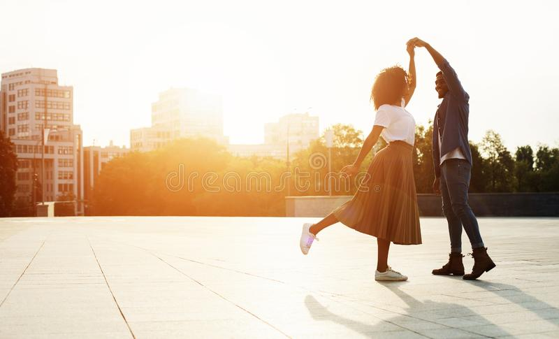 Love is in the air. Romantic couple dancing at sunset royalty free stock photo
