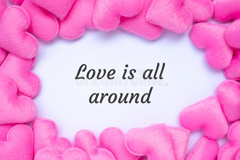 LOVE IS ALL AROUND word with pink heart shape decoration background. Love, Wedding, Romantic and Happy Valentine' s day holiday royalty free stock images