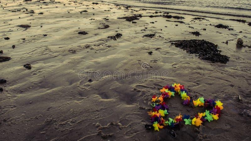 Love For All. Beautiful Flower Wreath Captured on the beach near Vejle, Denmark stock image