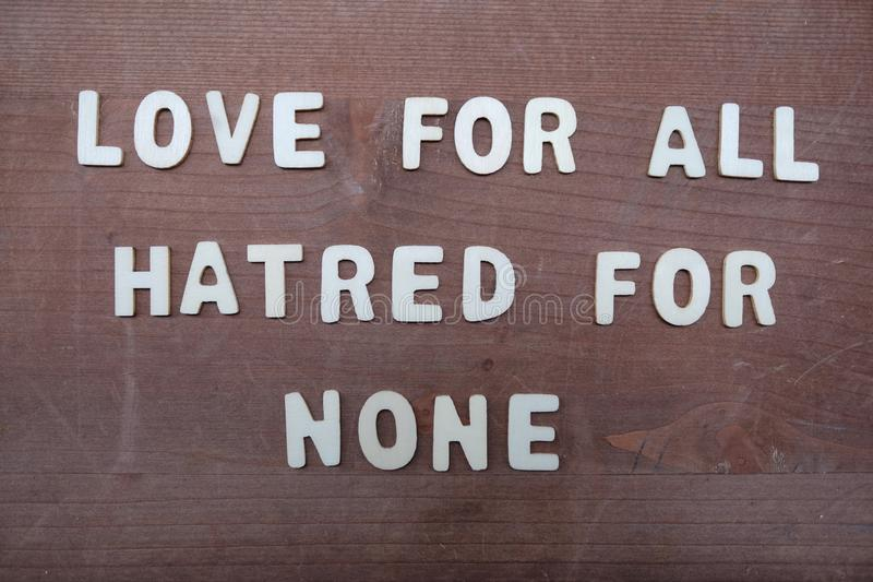 Love for all, hatred for none, peace quote phrase composed with wooden letters. Love for all, hatred for none, creative slogan for all humanity composed with royalty free stock photo