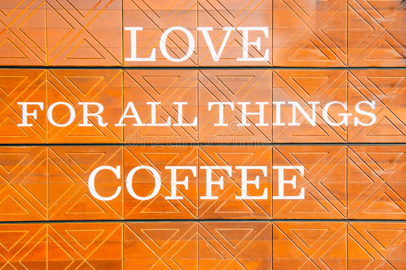 LOVE for all thing Coffee is message billboard on the wall. Text background stock images