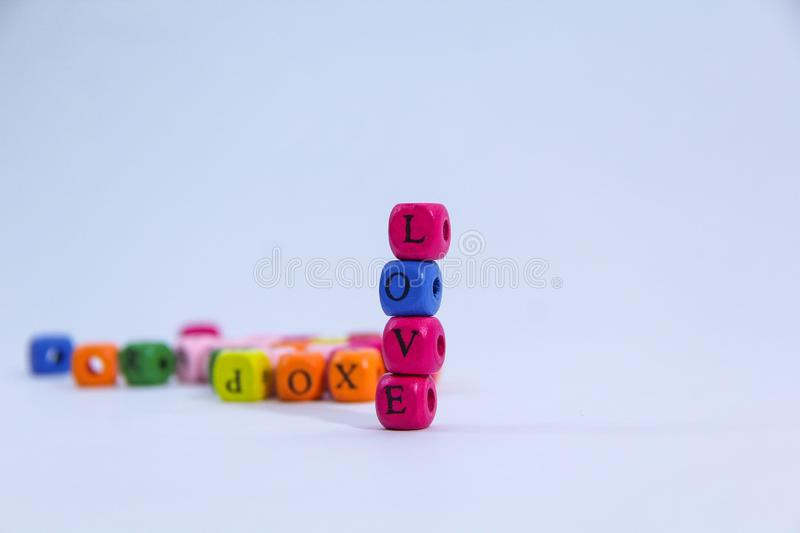 Love alphabet written on colourful stack wooden block with white background stock photo