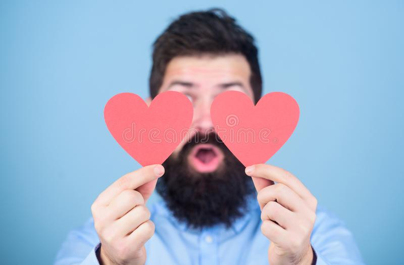 Love is amazing. Man bearded hipster with heart valentine card. Celebrate love. Guy attractive with beard and mustache royalty free stock image