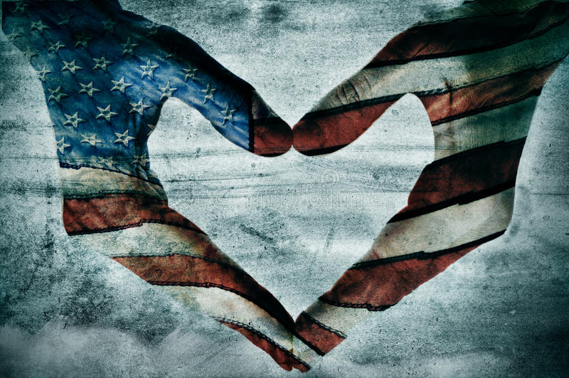 Love for america. Man hands painted as the american flag forming a heart stock image
