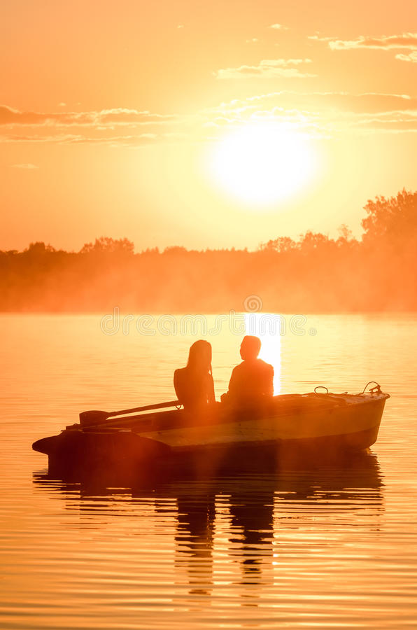 Free Love And Romantic Golden River Sunset. Silhouette Of Couple On Boat Backlit By Sunlight Stock Image - 85415211