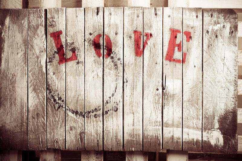 Love background. Wooden love dyed wooden plate in retro style stock images