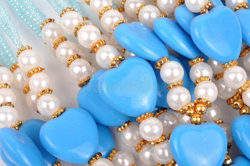Love beads. Very close up shot of love beads royalty free stock images