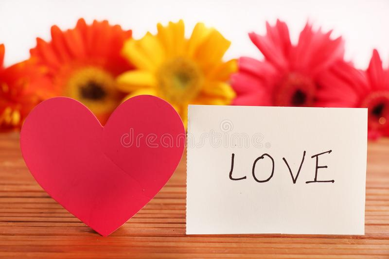 Love. Beautiful shot of love written on white chit stock images