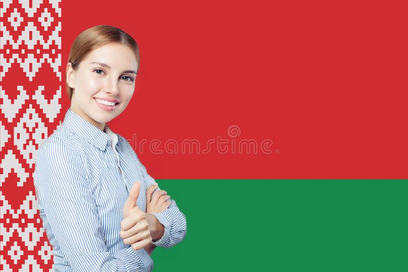 Love Belarus concept. Happy cute woman showing thumb up stock images